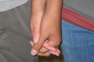 Couples who show affection in simple ways like holding hands have more positive perspective on their relationships.